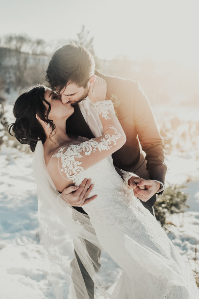 Eloping couple in snow.