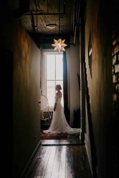 Bride getting ready at Refine Studios Airbnb in Springfield, Missouri.