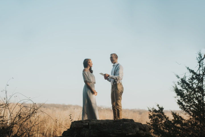 Couple eloping on cliff at Lake Springfield in Springfield, Missouri.